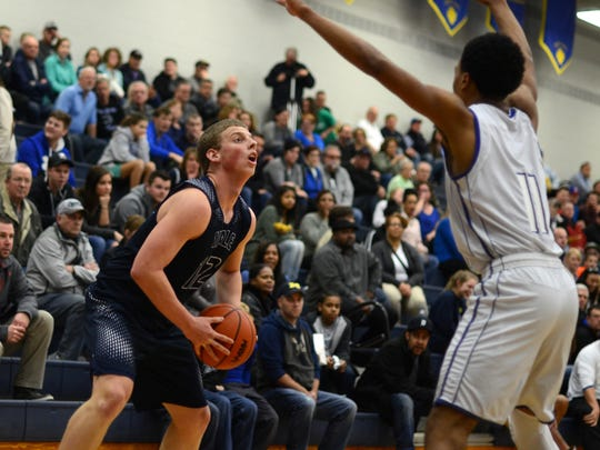 Yale Bulldogs' Luke McClelland looks to get by a defender Monday, Mar. 14, during a regional basketball game against Lake Fenton at Imlay City High School.