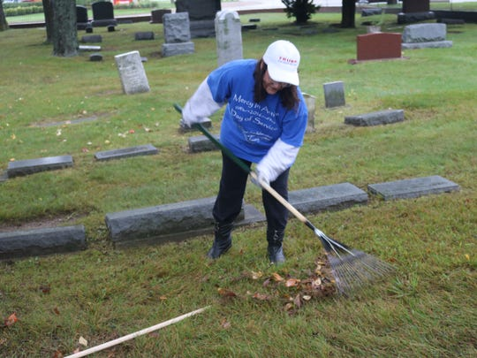 Kim Hudson works at West Farmington Cemetery for Mercy in Action Service Day in Farmington Hills.