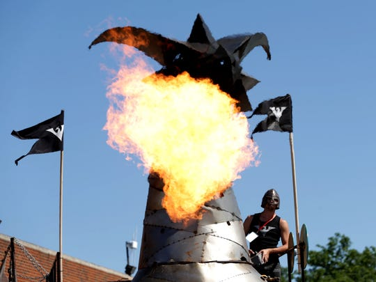 Kevin Bracken, 30, of Toronto, Ontario, Canada triggers the flames on his Heavy Meta dragon during Maker Faire Detroit at The Henry Ford in Dearborn, Michigan on Saturday, July 29, 2017.The dragon that took 20 people over 6 hours to build is 30 feet long and 19 feet high and is one of the popular attractions for people to stop by and watch.