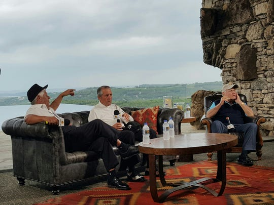 Golf legends Lee Trevino, from left, Gary Player and Jack Nicklaus visit in the wine cellar at Top of the Rock, in front of the infinity pool, on Thursday.