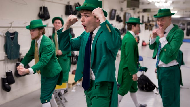 Hopeful leprechauns check their posing before tryouts in front of a about 200 students at a mock pep rally, University of Notre Dame, South Bend, Friday, April 20, 2018. Three leprechauns are chosen to represent the school and its cheerleading squad at a variety of games, pep rallies, and events throughout the upcoming school year.