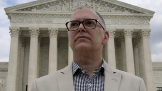 Over-the-Rhine resident Jim Obergefell stands in front of the United States Supreme Court.