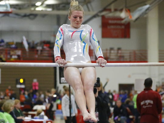 Wisconsin Rapids' Tia Dorshorst competes in the uneven