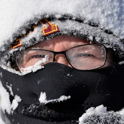 Milissa Preiss peers out from behind snow-covered glasses