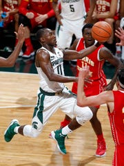 Michigan State's Tum Tum Nairn, left, goes up for a layup against Ferris State's TyQuone Greer Thursday, Oct. 26, 2017, in East Lansing, Mich.