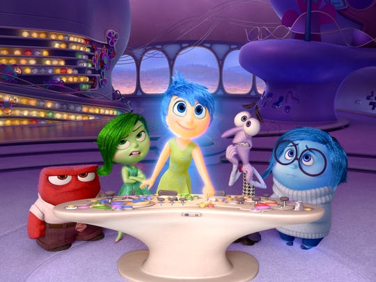 Anger (voice of Lewis Black), Disgust (Mindy Kaling), Joy (Amy Poehler), Fear (Bill Hader) and Sadness (Phyllis Smith) run the controls in 'Inside Out.'