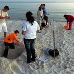 Students from Bailey Middle School excavatea demonstration sea turtle nest too close to the water along Johnson Beach Sunday evening.  Experienced volunteers created the nest to train the middle school students to learn how to identify and work with sea turtle nests which offers training that could possibly lead to volunteers  working in other programs in the Gulf Islands National Seashore.  The work is being done as part of the Turtle T.H.I.S (Teens Helping In the Seashore) program.