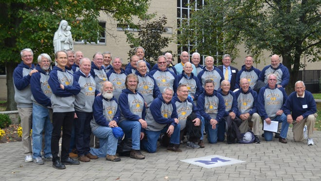 Moeller's 1965 undefeated team celebrated a weekend together Oct. 9-10. Coach Gerry Faust is at far right, front row.