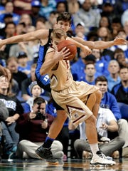 Elon's Steven Santa Ana (22) is tripped by Duke's Grayson Allen (3) in the first half of an NCAA college basketball game in Greensboro, N.C., Wednesday, Dec. 21, 2016. Allen was called for a technical foul on the play. (AP Photo/Chuck Burton)