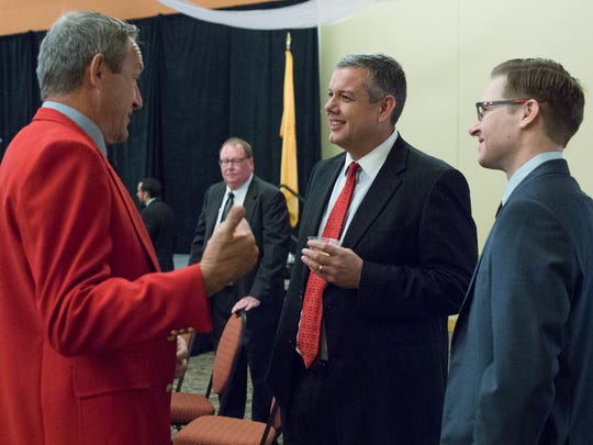 New Mexico State Senator Bill Soules, left, talks with Chris Lopez, director of site operations at Spaceport America and Zach DeGregorio, chief financial officer at Spaceport America, before the start of the 2016 Legislative Sendoff Breakfast at the Las Cruces Convention Center, Wednesday, December 14, 2016.