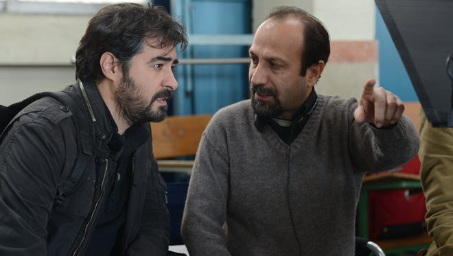 "Star Shahab Hosseini (left) and ""The Salesman"" director Asghar Farhadi on set."
