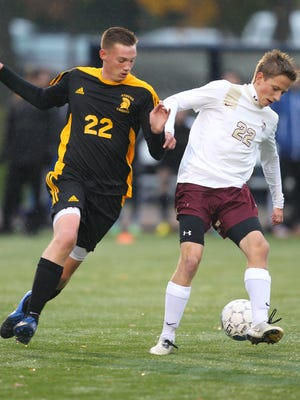 Greece Athena forward Zach Koons, left, shown tracking a Pittsford Mendon defender in last year's sectional final, uses his 6-foot-4 frame to help him score.