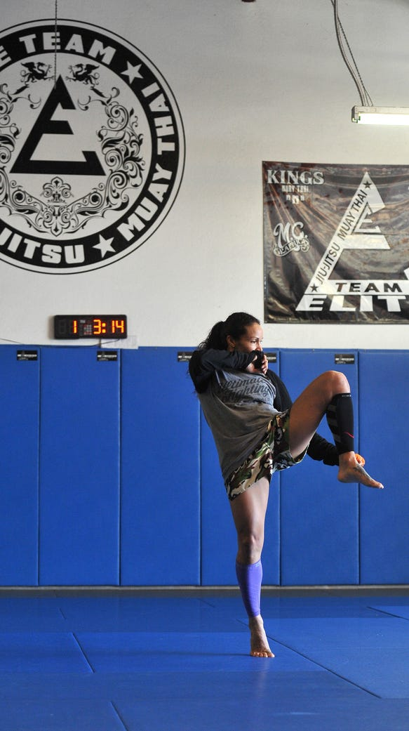 UFC fighter Marion Reneau warms up before training