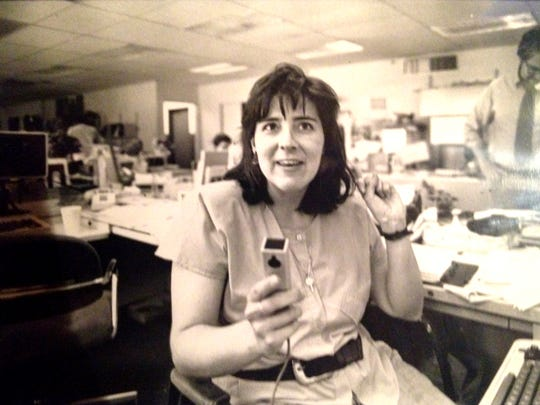 Detroit Free Press Staff Writer Patricia Montemurri at her desk circa mid-1980s.
