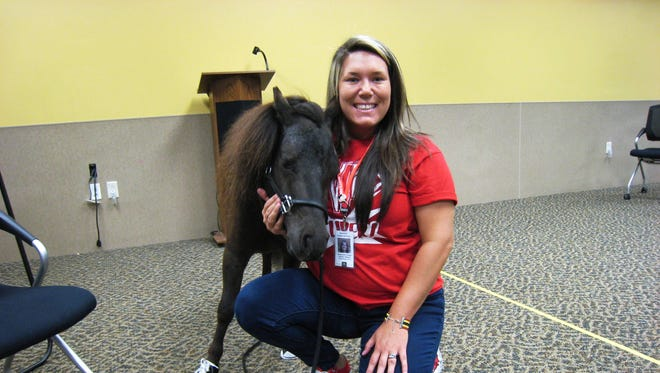 Michelangelo is a miniature therapy horse who has an important job in New Jersey: he visits assisted living facilities, nursing homes, and group homes, as well as schools for children with special needs.