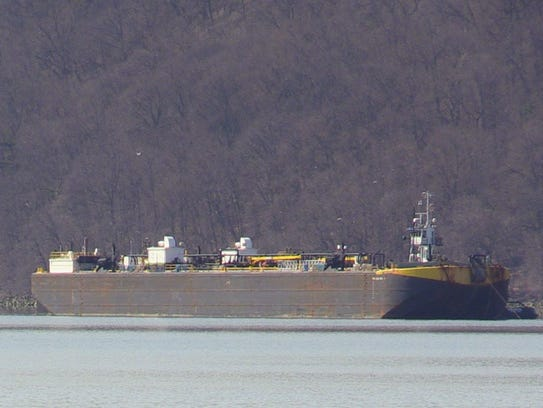 A barge in the Hudson River off Yonkers in March.