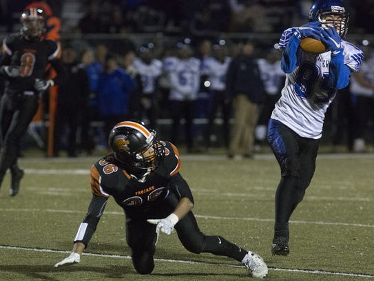 Lampeter-Strasburg's Jeff Elser, right, intercepts