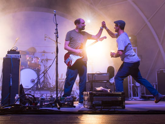 Built To Spill's Doug Matrsch (left) is high-fived
