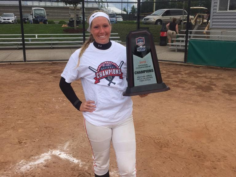 Glen Este's Brooke Parker shows off the winning tournament trophy in Portland, Oregon. Parker is next off to Bowling Green to play softball.