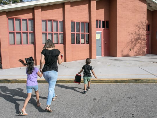 Diana Tapia drops off her son Alec, 3, to the day care
