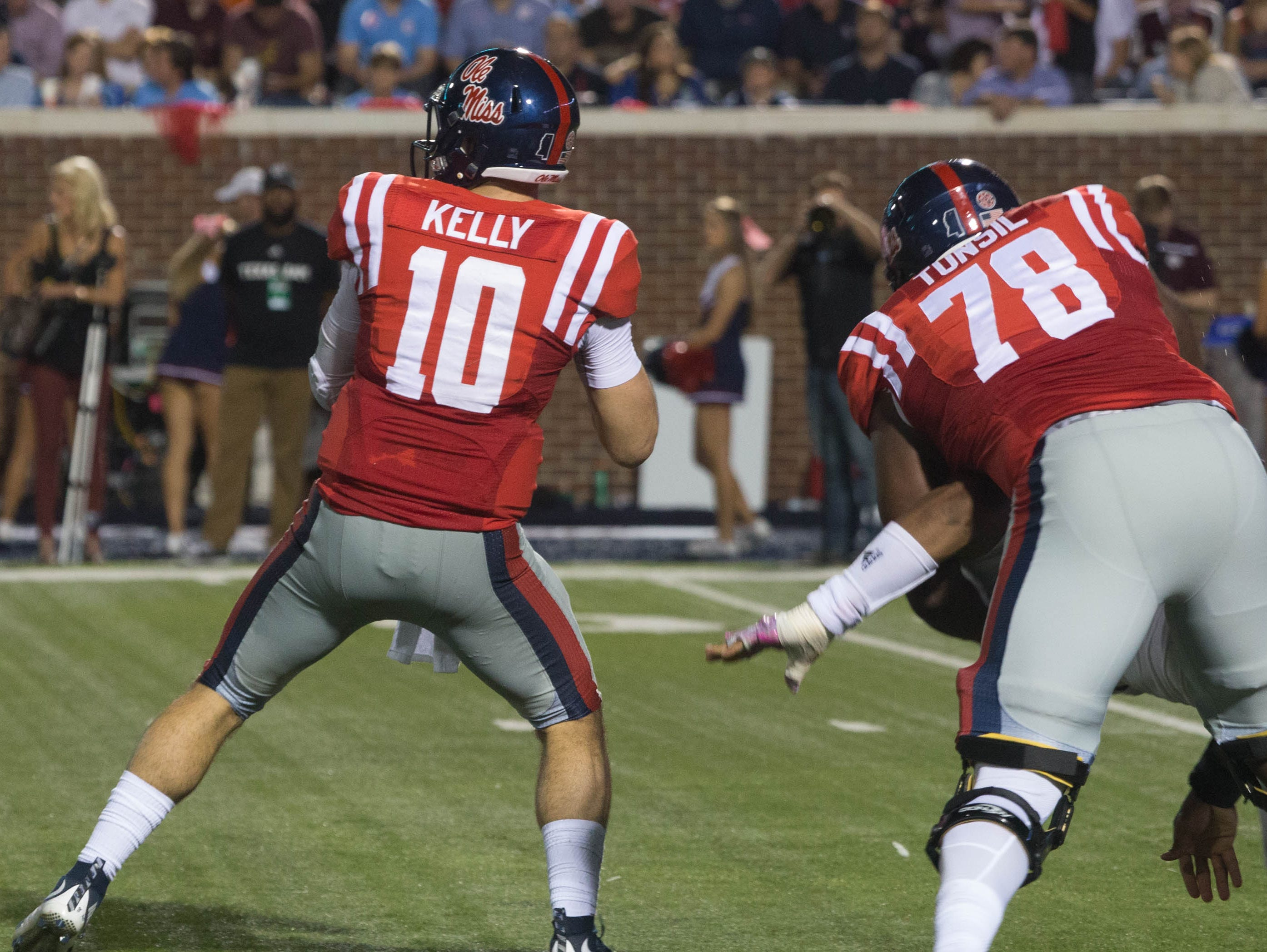Ole Miss' Laremy Tunsil tackles Myles Garrett allowing Chad Kelly to throw the pass.