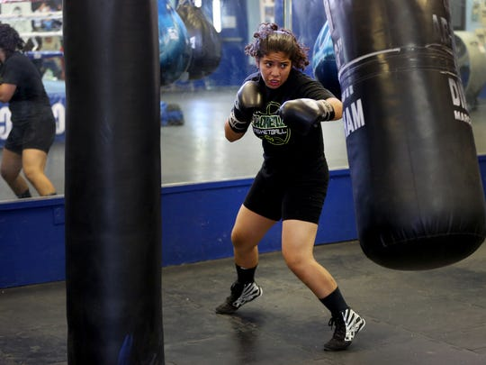 Citlalli Ortiz warms up with a heavy bag at the Coachella Valley Boxing Club.