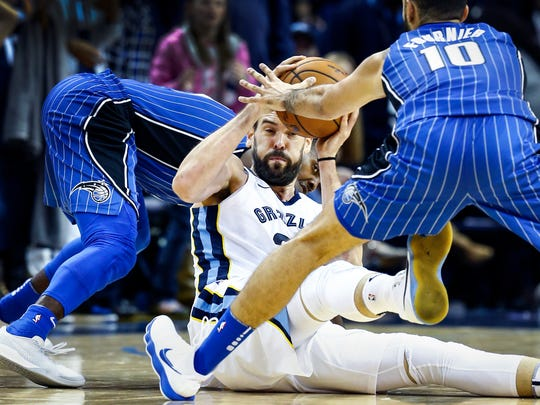 Memphis Grizzlies center Marc Gasol (middle) battles Orlando Magic defenderEvan Fournier (right) for a loose ball during fourth quarter action at the FedExForum in Memphis, Tenn., Wednesday, November 1, 2017.