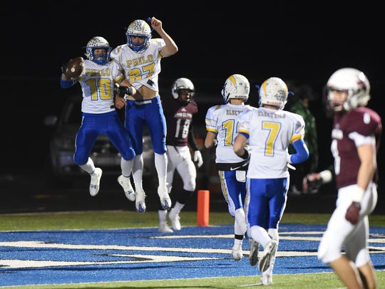 Philo's Lane Deal (67) and Cole Smith celebrate Smith's