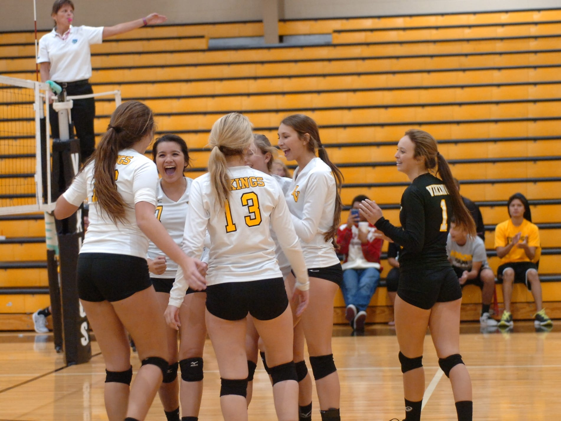 The Bishop Verot girls volleyball team celebrates after winning a point during its District 4A-10 win on Thursday