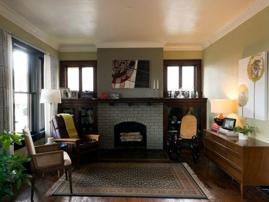 A fireplace and built-in shelves anchor one end of