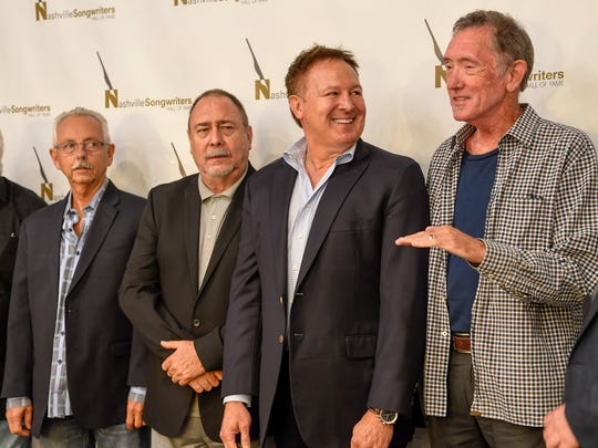 Buddy Canon, who accepted for Vern Gosdin, Jim McBride, Tim Nichols and Walt Aldridge pose for a photograph during a press conference announcing that they will be inducted into the Nashville Songwriters Hall of Fame in October, at Columbia Studio A in Nashville, Tenn., Wednesday, Aug. 9, 2017.