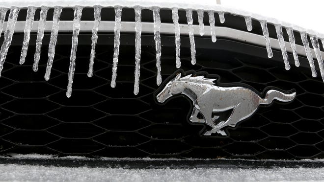 Icicles accumulate on the front of a Ford Mustang on W. Second Avenue on Tuesday afternoon. A mixture of snow, sleet and freezing rain coated parts of south and central Kansas on Monday and Tuesday with weather forecasters predicting highs in the mid 60s for Halloween on Saturday.