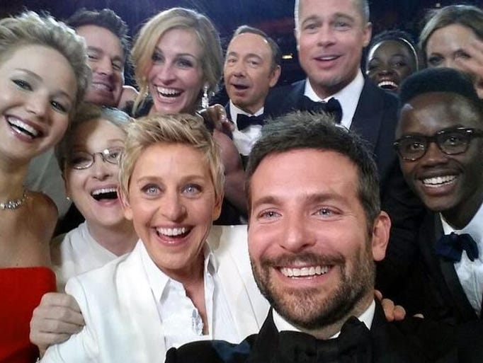 "This image released by Ellen DeGeneres shows actors front row from left, Jared Leto, Jennifer Lawrence, Meryl Streep, Ellen DeGeneres, Bradley Cooper, Peter Nyong?o Jr., and, second row, from left, Channing Tatum, Julia Roberts, Kevin Spacey, Brad Pitt, Lupita Nyong?o and Angelina Jolie as they pose for a ""selfie"" portrait on a cell phone during the Oscars at the Dolby Theatre on Sunday, March 2, 2014, in Los Angeles."