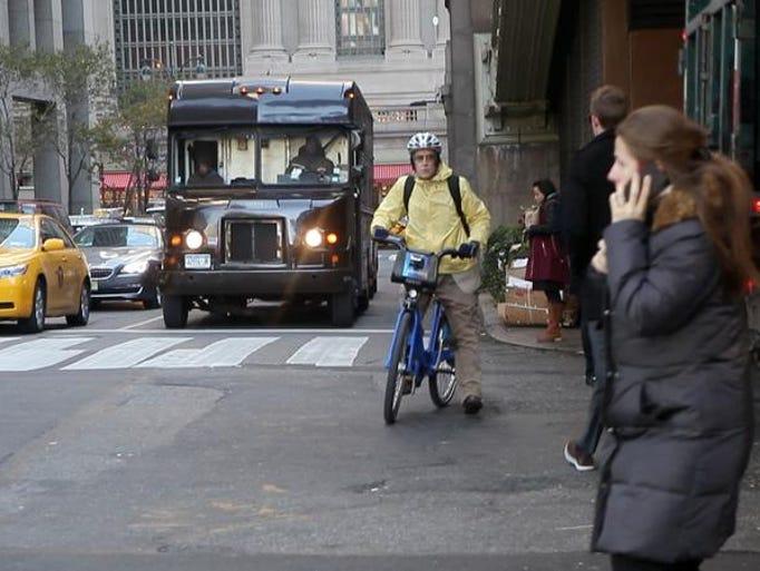 New Rochelle resident Damon Maher rides his bike to work using the New York's bike-share program in Manhattan Nov. 14, 2013.