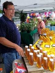 Ted Kroeger of Kroeger Greenhouse and Water Gardens and his products at the Historic Newburgh Farmers Market in 2018. The market opens for 2019 Saturday.