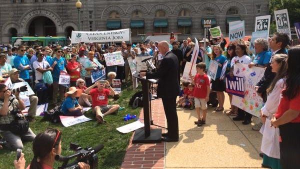 Gov. Jack Markell speaks during a rally for environmental groups Tuesday outside the EPA building.