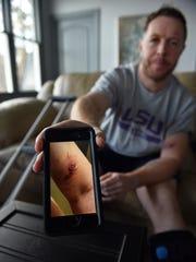 Tornado survivor Martin Rich shows pictures on his