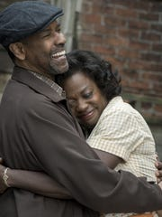 "Denzel Washington and Crossroads Theatre alum Viola Davis in a scene from the 2016 adaptation of August Wilson's Pulitzer Prize-winning play ""Fences."" A friend since college with Crossroads Board President Anthony P. Carter, Washington will be honored with the inaugural Ossie Davis and Ruby Dee Living Legends Award at the Tony-winning regional theater company's Oct. 19 fundraising gala, ""A Night with Crossroads."""