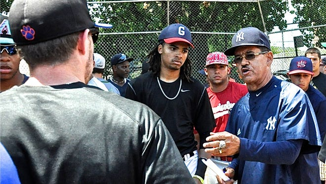 Yankees area scouting director Cesar Presbott talks with former Purchase College shortstop Michael Skoller, left, who once played for him in high school on an all-star team Presbott took to his native Dominican Republic.