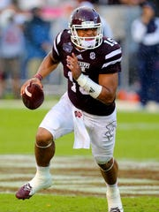 Mississippi State quarterback Dak Prescott (15) has risen to the top of this week's Cenla's Heisman ballot, receiving 12 of the 15 first-place votes cast.