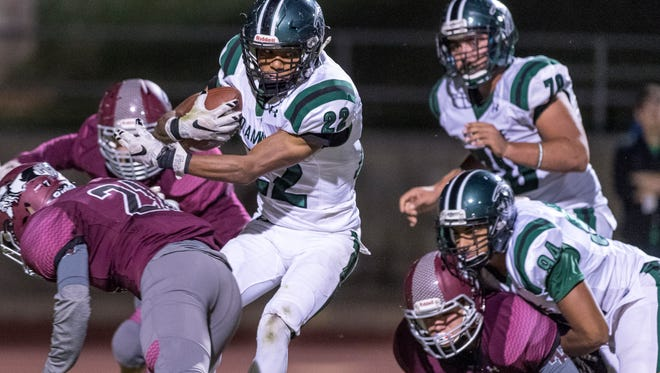 El Diamante's Devontae Freeman runs against Mt. Whitney in a West Yosemite League high school football game on Friday, September 22, 2017.