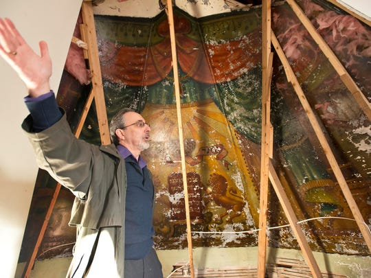 Aaron Goldberg in 2013 explains the history behind a mural that was painted in 1910 and has been uncovered behind a wall in an apartment building that used to be an orthodox synagogue in Burlington.