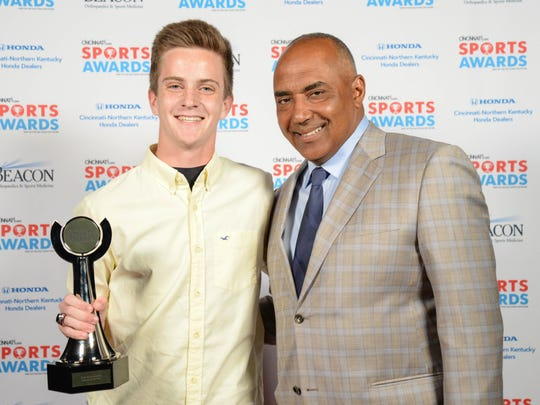 Dustin Horter, of Lakota East High School and Boys Cross Country Runner of the Year, with Bengals Head Coach Marvin Lewis during the 2017 Cincinnati.com Sports Awards at the Aronoff Center Monday May 22, 2017.