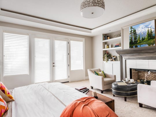 A photograph of a modern bedroom in white