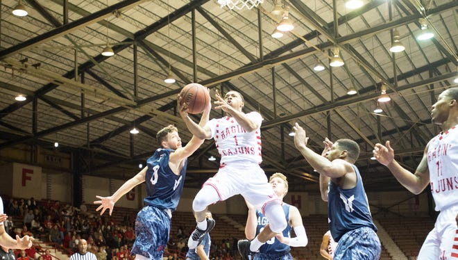 Jay Wright takes the ball to the basket as the Cajuns beat Panhandle State last week.