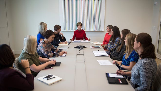Velda Hughes, owner of the Hughes Agency, speaks to her employees inside the company's new building at 110 E. Court St. on Oct. 10, 2017. The space is twice as large as their old offices on Main Street.