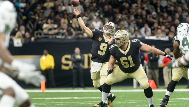 Saints quarterback Drew Brees throws a pass as The New Orleans Saints beat the New York Jets 31-19 in the Mercedes-Benz Superdome. Sunday, Dec. 17, 2017.