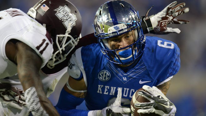 UK WR Blake Bone makes a catch during the second half of the University of Kentucky's football game against Mississippi State in Lexington, Ky. Saturday, October 25, 2014.