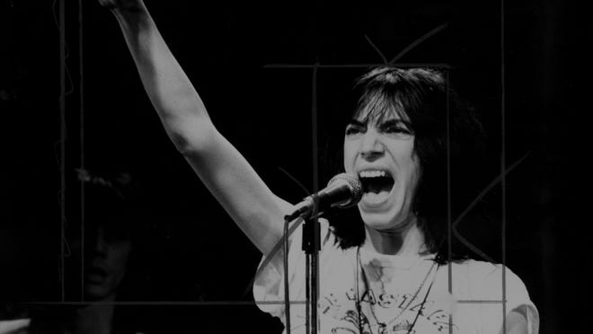 Patti Smith sings at the Tower Theater in Upper Darby, Pennsylvania, in 1976.