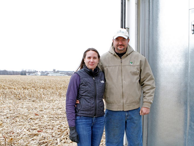 Kim and John Koepke stand outside the walk-in cooler